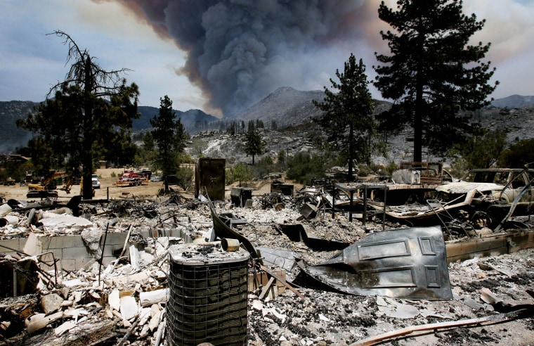 Image: The burned remains of one of the homes on Bonita Vista Rd. near Lake Hemet, Calif., from the Mountain Fire.