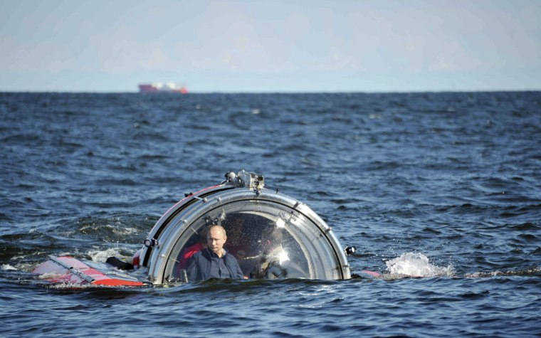 Image: Russia's President Vladimir Putin is seen through the glass of C-Explorer 5 submersible after a dive in the Baltic Sea