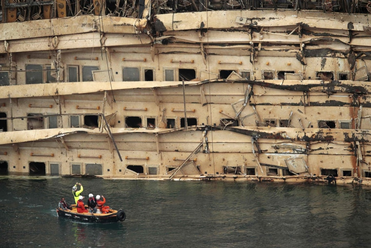 "Image: The damaged side of the capsized cruise liner Costa Concordia is seen at the end of the ""parbuckling"" operation outside Giglio harbour"