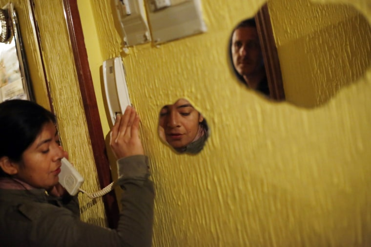Image: Maira Jumbo, who holds dual citizenship in Spain and Ecuador, answers a phone call before learning that her family's eviction had been suspended, at her home in Madrid