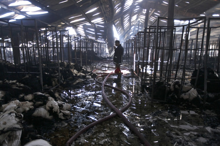Image: Factory fire kills at least nine in Bangladesh