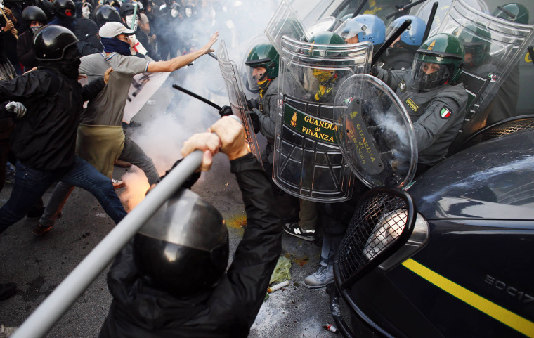 Image: Protesters clash with Guardia di Finanza during a protest in front of the Ministry of Finance building in downtown Rome