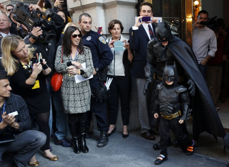 Image: Leukemia survivor Miles enjoys a day as Batkid, arranged by the Make-A-Wish Foundation, in San Francisco, California