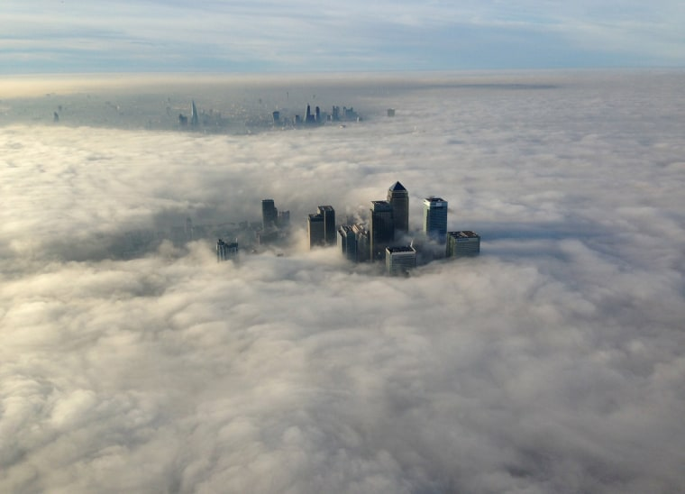 Image: The Canary Wharf business district of east London taken from the Metropolitan Police helicopter is seen during a foggy morning in this photograph received via the Metropolitan Police in London