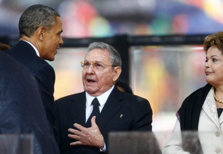 Image: U.S. President President Obama greets Cuban President Raul Castro