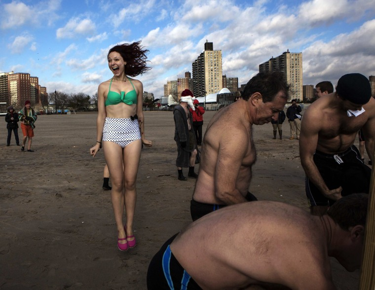 Image: Members of the Coney Island Polar Bear Club warm up before swimming at the beach at Coney Island in New York