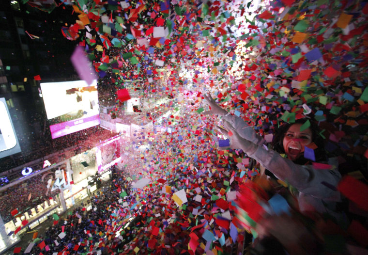 Image: Confetti is dropped on revelers at midnight during New Year's Eve celebrations in Times Square in New York