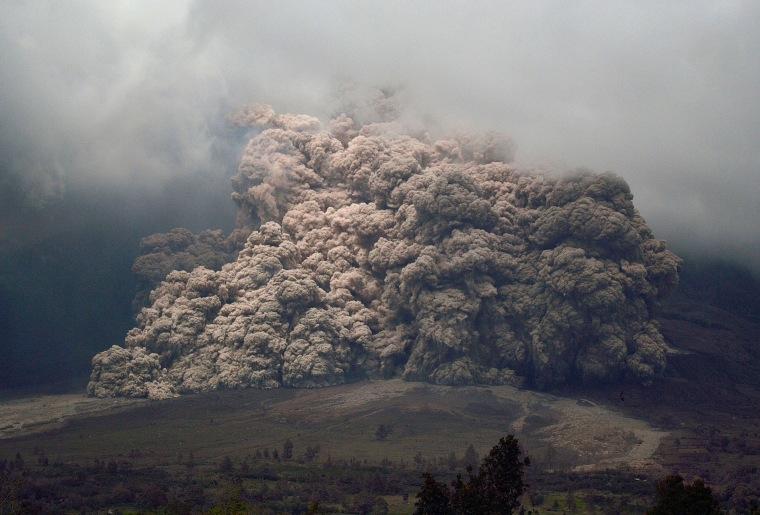 Image: Mount Sinabung spews ash during an eruption.