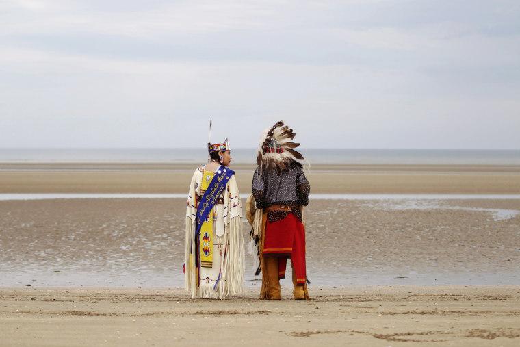 Image: Descendants of Comanche indian soldiers prays on Utah Beach