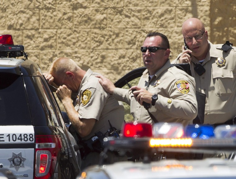 Image: Metro Police officers are shown outside a Wal-Mart after a shooting in Las Vegas