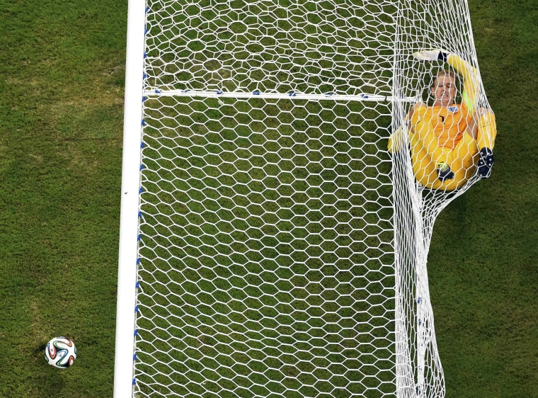 Image: England's goalkeeper Hart rolls inside the goalpost after Italy's Balotelli scored during their 2014 World Cup Group D soccer match at the Amazonia arena in Manaus