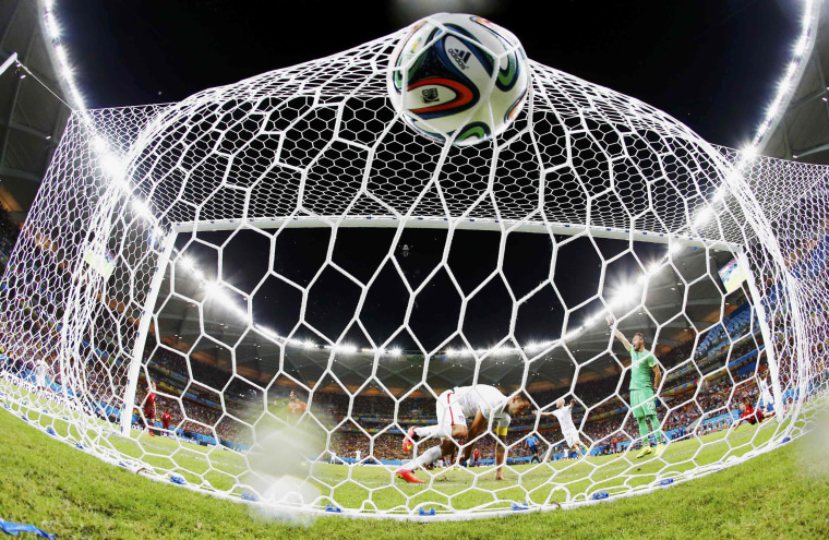 Image: Dempsey of the U.S. knocks the ball into the net to score against Portugal during their 2014 World Cup Group G soccer match at the Amazonia arena in Manaus