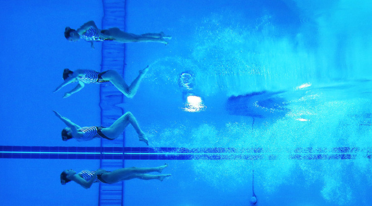 Image: Japan's Inui and Mitsui perform in the women's duet technical routine synchronised swimming competition during the 17th Asian Games in Incheon