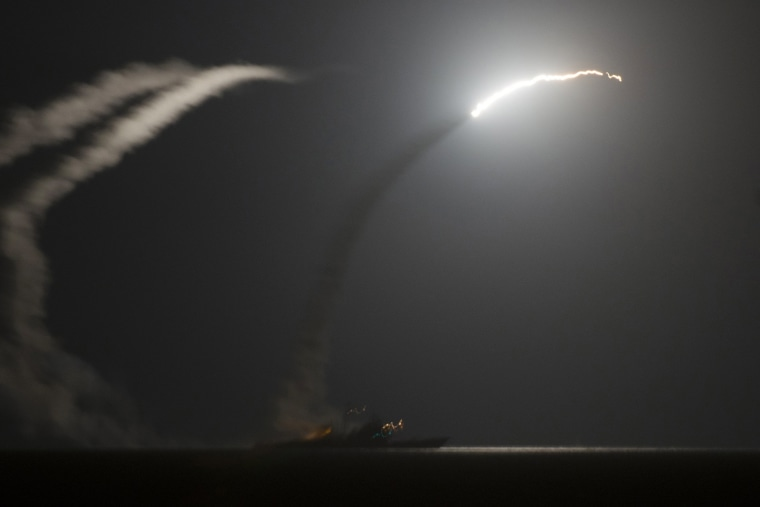 Image: The guided-missile cruiser USS Philippine Sea  launches a Tomahawk cruise missile while conducting strike missions against ISIL targets from the Arabian Gulf