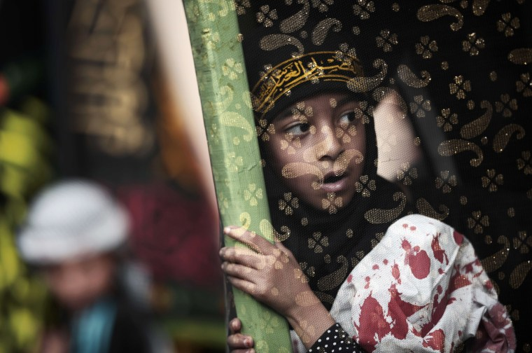 Image: TOPSHOTS-BAHRAIN-RELIGION-ISLAM-SHIITE-ASHURA