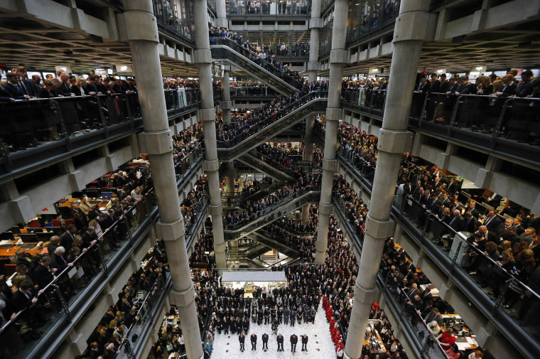 Image: Lloyds of London staff hold their annual Remembrance Day service at the Lloyds Building in the City of London