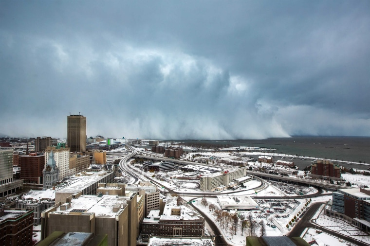 Image: Storm clouds and snow blows off Lake Erie in Buffalo, New York