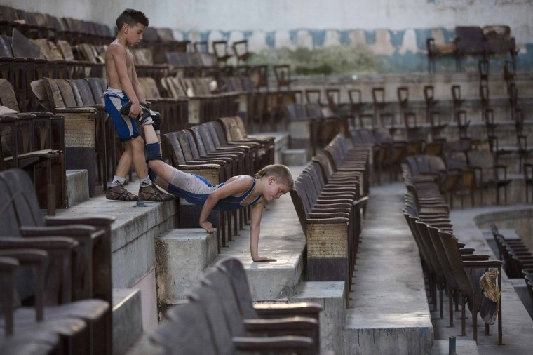 Image: Children exercise before a wrestling practice session at an old Basque ball gymnasium in downtown Havana