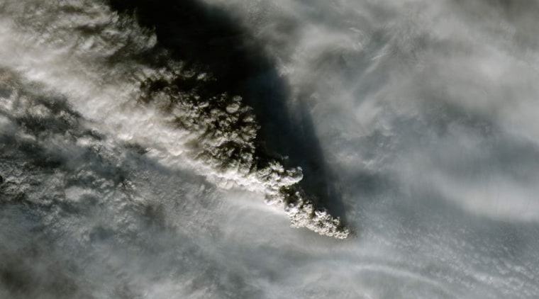 Image: A plume of smoke from Alaska's Pavlof volcano is pictured in this NASA handout satellite image