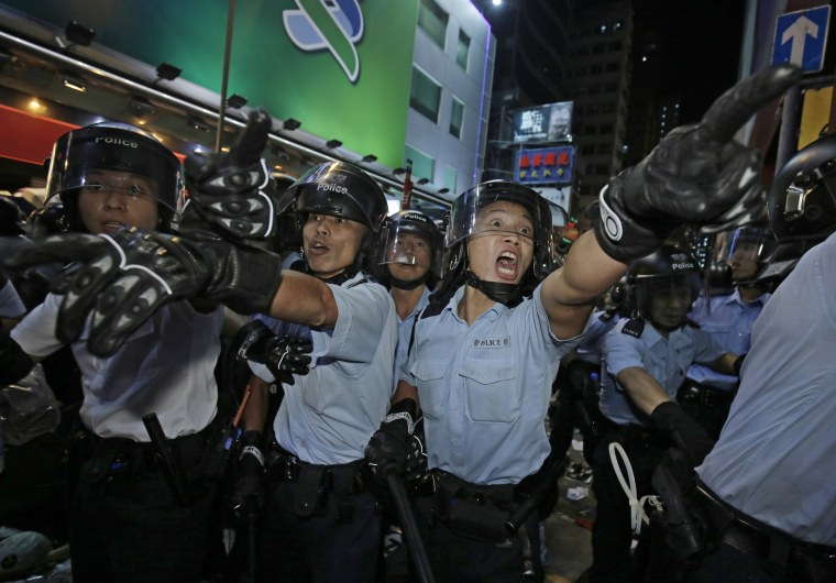 Image: Police officers shout at protesters at an occupied area in Mong Kok district of Hong Kong