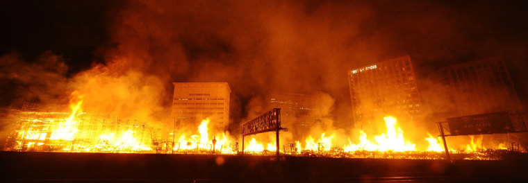 Image: Flames spread from a massive fire at the site of a seven-storey downtown apartment complex under construction in Los Angeles