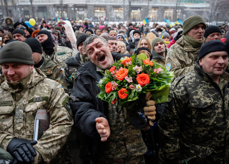 "Image: Servicemen of ""Kiev 12"" military defence battalion react as they take part in a welcoming ceremony in Kiev"