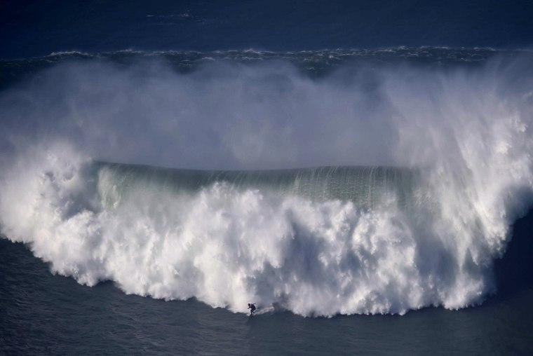 Image: TOPSHOTS-PORTUGAL-SURF-WAVES