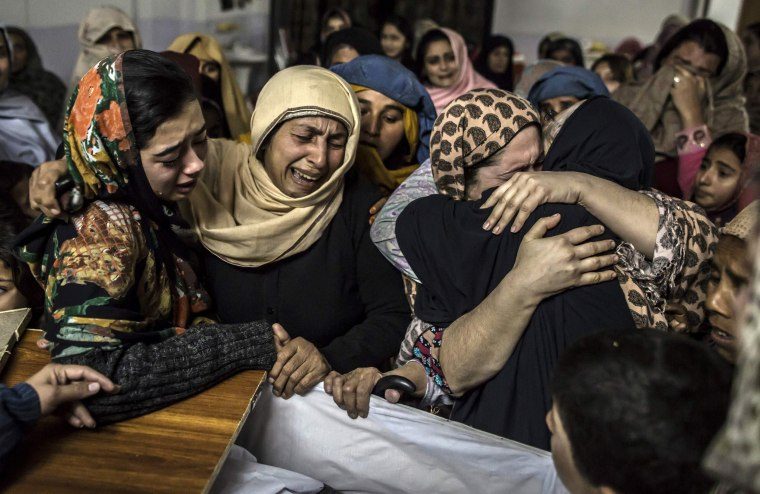 Image: Women mourn their relative Mohammed Ali Khan, a student who was killed during an attack by Taliban gunmen on the Army Public School, at his house in Peshawar