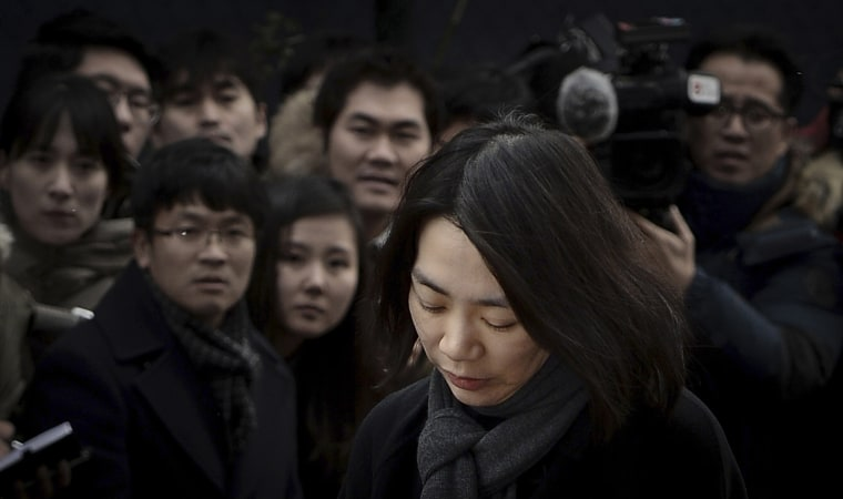 Image: Cho Hyun-ah, daughter of chairman of Korean Air Lines, appears in front of the media outside the offices of the Aviation and Railway Accident Investigation Board in Seoul