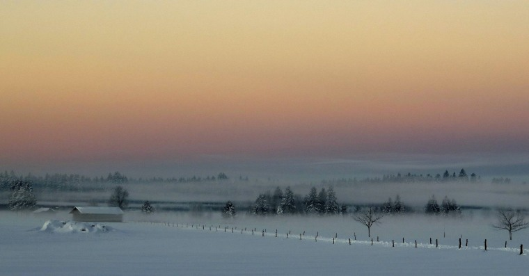 Image: Ground fog lies on a field during the first sunrise of 2015 on a field near Warngau