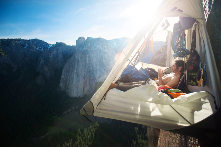 Kevin Jorgeson looks out to California's Yosemite National Park while hanging off of Dawn Wall on the El Capitan mountain on January 4, 2015.