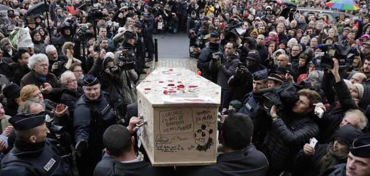 Image: Pallbearers carry the coffin of late satirical French magazine Charlie Hebdo cartoonist after a tribute at the Montreuil town hall