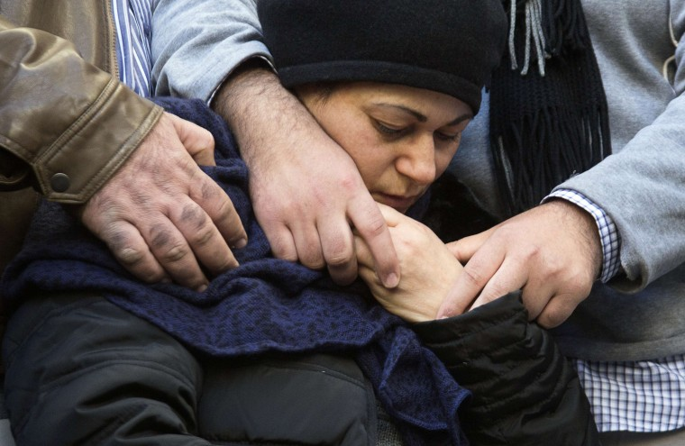 Image: Mother of victim of attack on a Paris grocery comforted during a procession near Tel Aviv