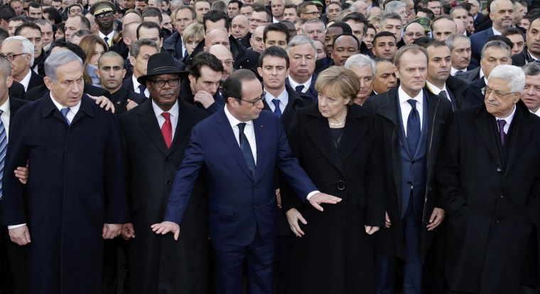Image: French President Francois Hollande is surrounded by heads of state attends the solidarity march (Marche Republicaine) in the streets of Paris