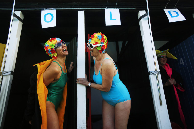 Image: Swimmers prepare to get into the water during the UK Cold Water Swimming Championships at Tooting Bec Lido in south London