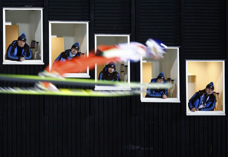 Image: Finland's Ahonen soars past judges windows during the normal hill HS100 mixed team ski jumping event of the Nordic World Ski Championships in Falun