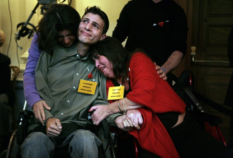 Image: Michael Oliveri, a muscular distrophy patient, with his mother, Christiane, left, and Diane Rivera-Riportella in Trenton, N.J., on Monday, Jan. 11, 2010.