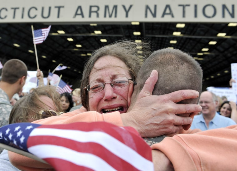Image: Janet Allegra, of Ellington, hugs her son Spc. John Allegra IV at the Army aviation support facility in Windsor Locks, Conn.