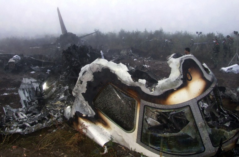 Image: The wreckage of a crashed passenger plane is seen in Yichun
