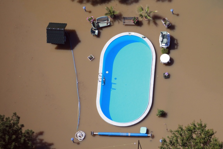 Image: Garden with swimming pool is inundated by waters of Elbe river during floods near Magdeburg