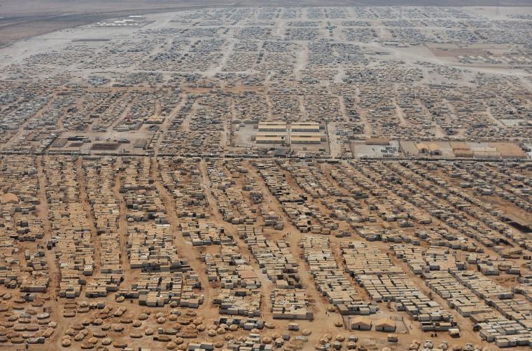 Image: TOPSHOTS 2013-JORDAN-US-SYRIA-REFUGEES-KERRY