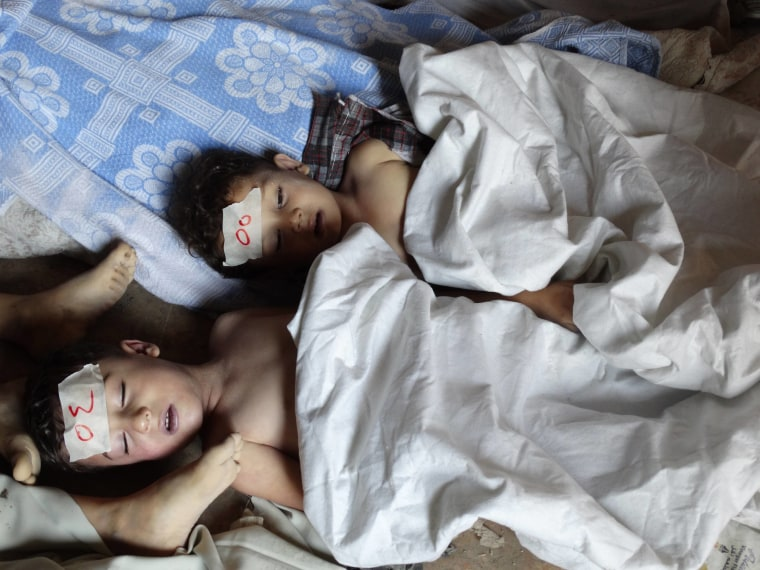 Image: A view shows  bodies of children activists say were killed by nerve gas in the Ghouta region, in the Duma neighbourhood of Damascus