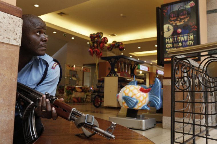 Image: A police officer tries to secure an area inside the Westgate Shopping Centre where gunmen went on a shooting spree in Nairobi