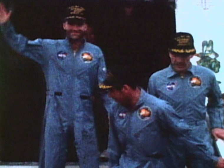 Apollo 13 astronauts Fred Haise, Jack Swigert and Jim Lovell return to Earth on April 17, 1970, after a nearly fatal accident in space.