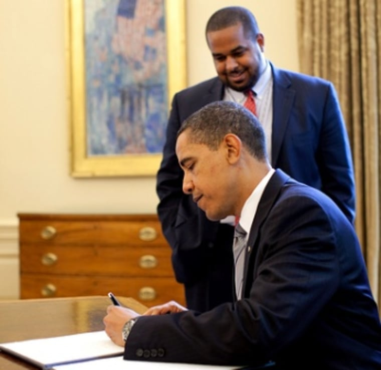 The director of the White House Office for Faith-Based and Neighborhood Partnerships, Joshua DuBois, looks on as President Obama signs the proclamation marking May 7, 2009 a national day of prayer.