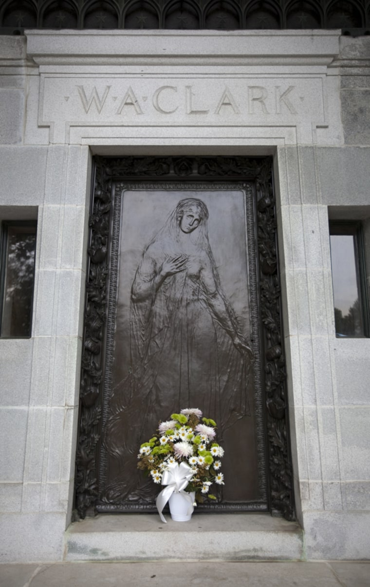Flowers at the bronze door of the Clark mausoleum, where Huguette Clark was entombed on Thursday.