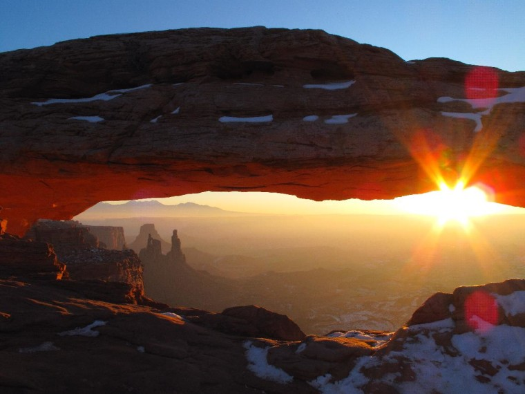 The extraordinary sunrise at Mesa Arch in Canyonlands National Park.  This photo was taken on December 20th, 2009.  It was 13 degrees outside and the cold air made for fantastic colors.  It was pure joy to be there and experience that sunrise.