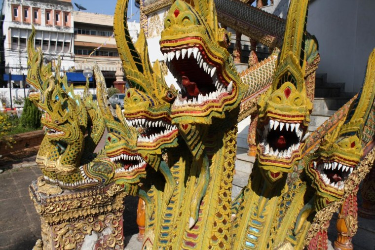 While on our honeymoon in Chiang Mai, Thailand, my wife and I visited numerous Wats (Buddhist Temples). Guarding the entrance of every Wat was a pair of Dragons, like these.