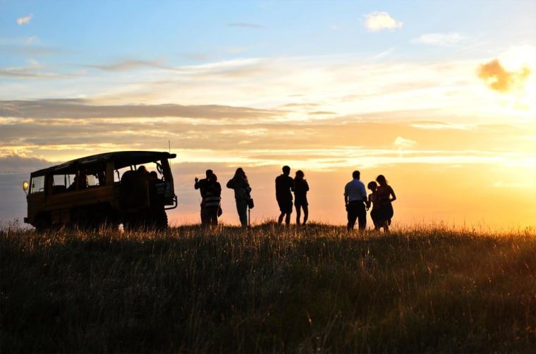 Models and photographers admire a Costa Rican sunset.