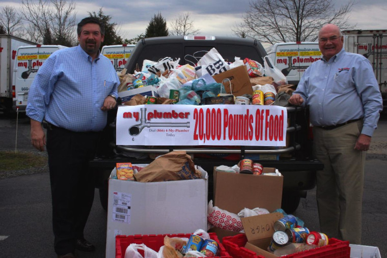 Mark and Wendell Presgrave with some of the collected food that will be distributed to needy people in the D.C. metropolitan area.